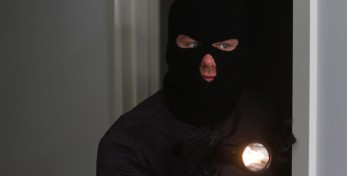 Burglar holding flash light