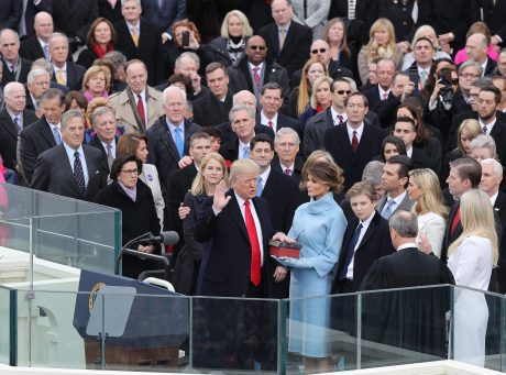 epa05735406 President-elect Donald J. Trump (L) takes the oath of office as the 45th President of the United States in Washington, DC, USA, 20 January 2017. Trump won the 08 November 2016 election to become the next US President.  EPA/JUSTIN LANE